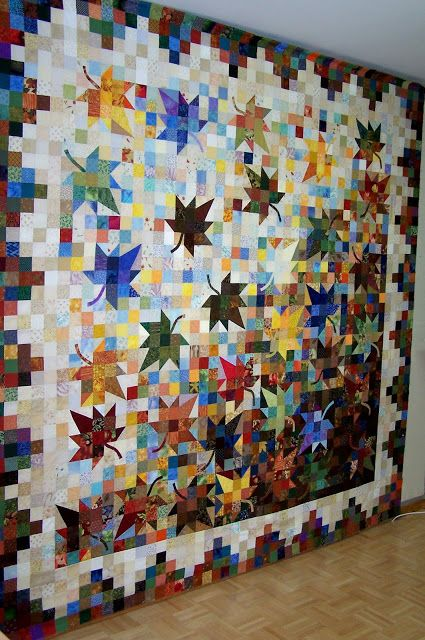 "'Falling Leaves':  The raffle quilt for the Assiniboine Circle Quilter's quilt show (Sept. 2013) - quilted by Corina W. from Manitoba, Canada;  Each member received a kit to make a 10"" maple leaf block, a friend appliqued the stems down, then Corina and another friend arranged them on her design wall (along with an additional 1500 or so 2 1/2"" squares).  WOW!"