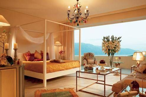 Relax with your loved one in an elegant room with romantic touches, such as a four-poster bed. Overlooking the Ionian Sea, Grecotel Eva Palace in Corfu, is the place to be