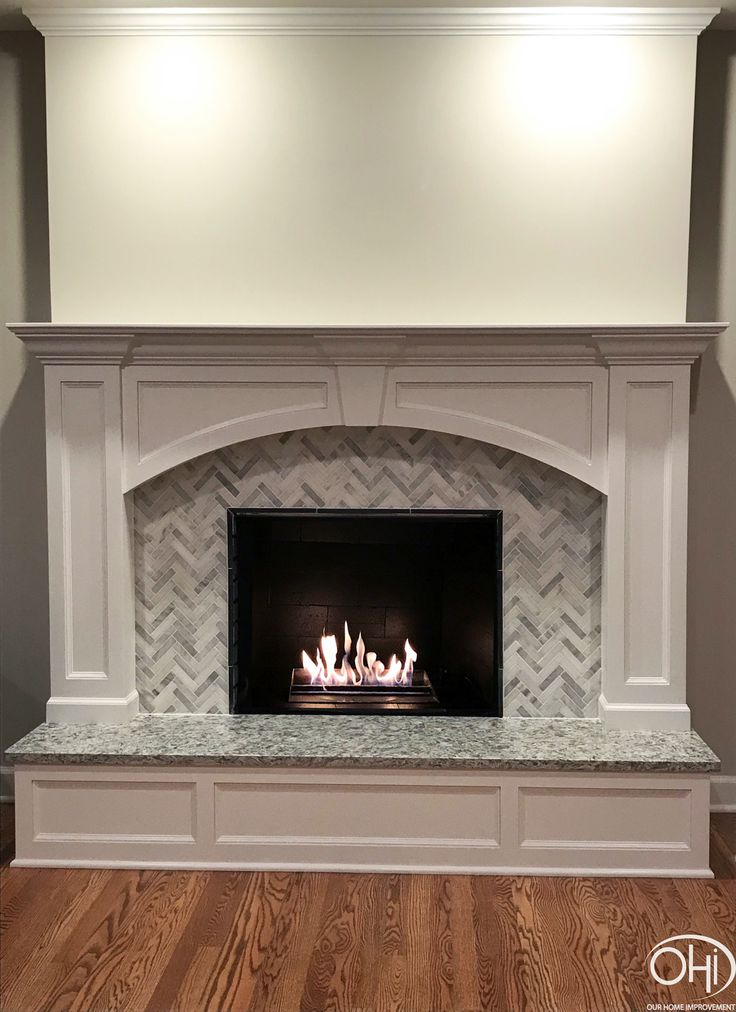 Fireplace With Wood Panels Herringbone Tile And A