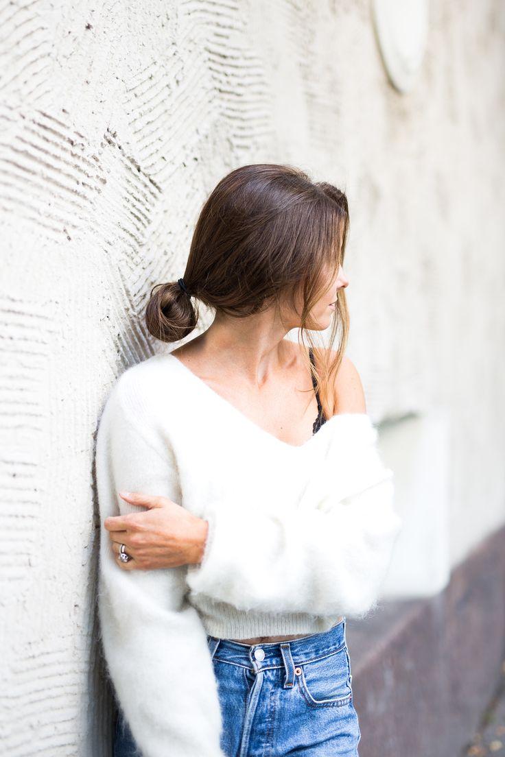 low bun, off shoulder, white sweater, blue jeans, levis 501, bralet