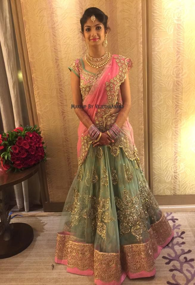 Indian bride Akshata wears bridal lehenga and jewellery for her Reception. Makeup and hairstyle by Vejetha for Swank Studio. Find us https://www.facebook.com/SwankStudioBangalore