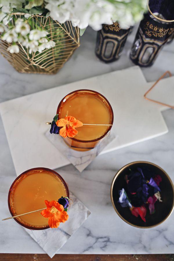 Moroccoan-inspired Bourbon Green Tea Punch Recipe with floral garnish | via coco+kelley