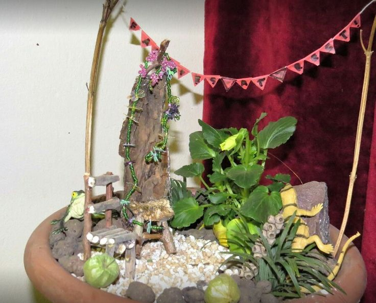 Two fairy chairs in miniature gardeb