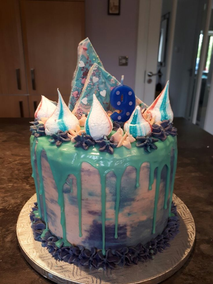 "4 layers 8"" Vanilla cake with pink and purple buttercream, teal drip, meringue kisses and white chocolate scards"