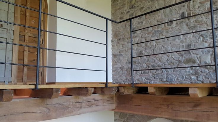 Wooden walk way, hand made rail, custom made door, all by our group for a renovation project in Umbria.