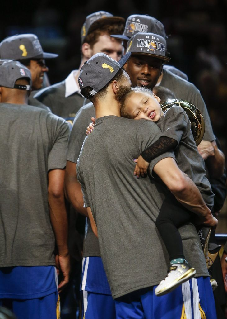 Golden State Warriors' Stephen Curry holds his daughter after Game 6 of The NBA Finals between the Golden State Warriors and Cleveland Cavaliers at The Quicken Loans Arena on Tuesday, June 16, 2015 in Cleveland, Ohio. The Golden State Warriors defeated the Cleveland Cavaliers 105 to 97 to win the NBA Finals title 4 games to 2. Photo: Scott Strazzante, The Chronicle