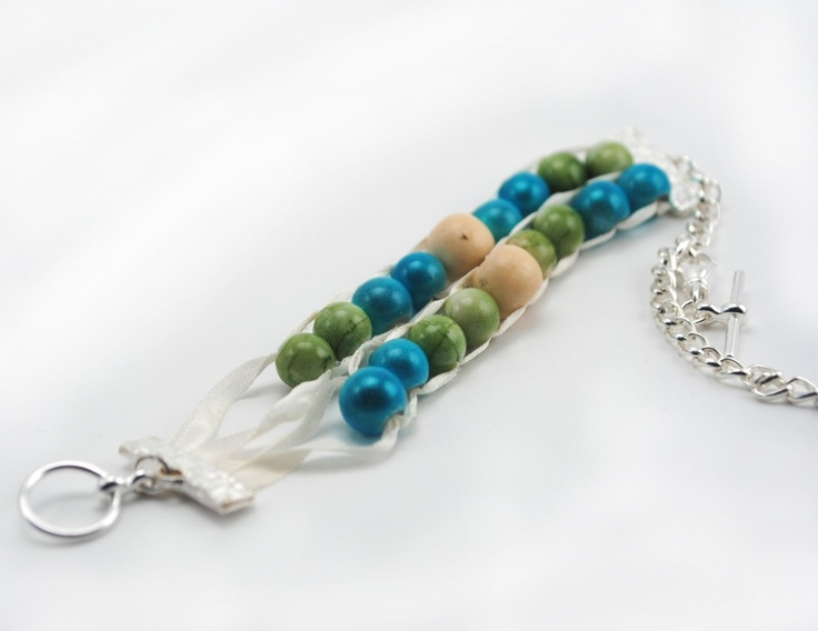 resin beads in light green and light blue compliment the cream colored