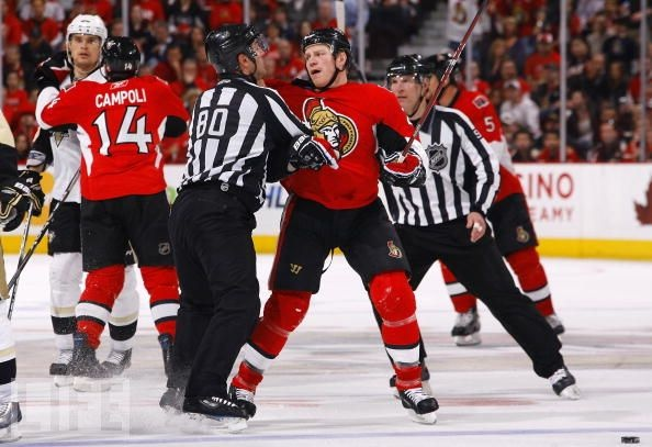 hes kinda like the 'fighter' of the team.. when he checks u dont get back up. he may be shorter than some players but he sure know how to stand his ground, #25,Chris Neil, of the Ottawa Senators