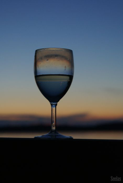 Glass of Wine under a Sunset by a Lake