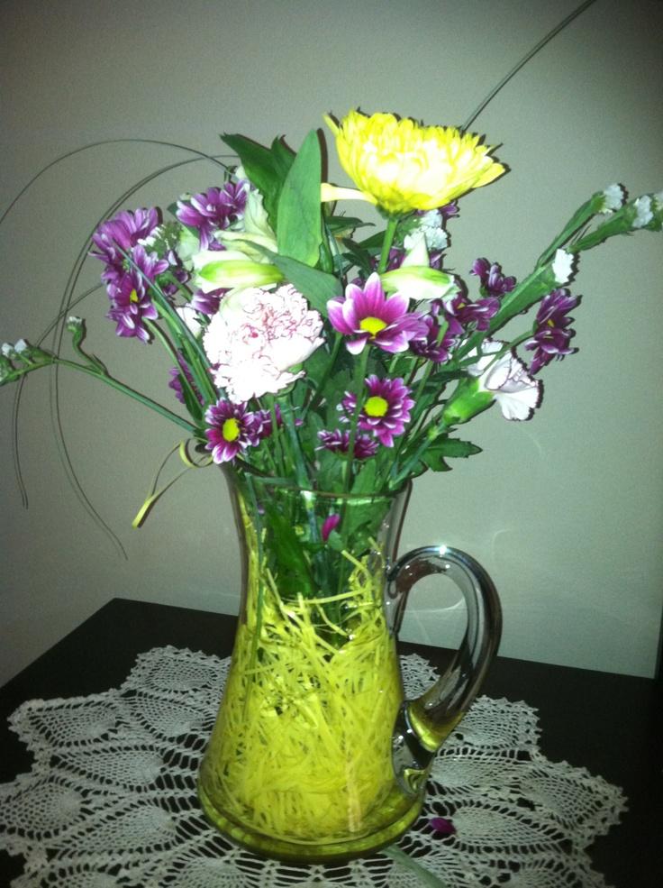 Reasonable Easter arrangement. Aldi flowers $3.99 / Dollar Tree grass bag $1