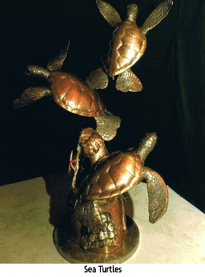 Sea Turtles - Contact us for Hawaiian art, including Hawaiian honu sea turtles, pacific green sea turtles, and Hawaiian sculpted gates. We can create a beautiful tropical sculpture that you will love.