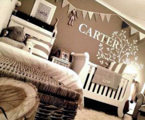 A neutral nature themed baby nursery decorated in earth tones including varying shades of dark chocolate brown, tan, cream and antique white with DIY craft projects that you can make yourself to save money.
