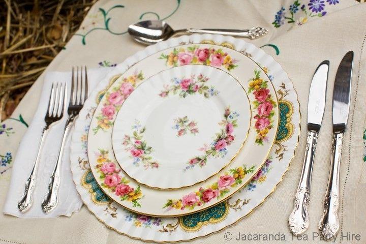 Royal Albert and Royal Doulton mixed vintage dinner setting.