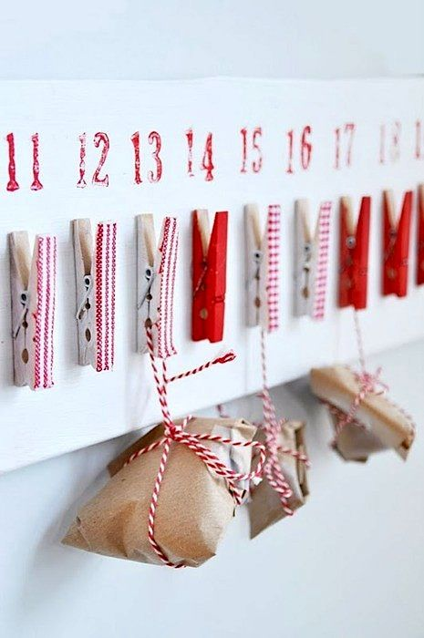 Baker's twine, craft paper, and painted clothespins hold 25 little packages. Do puzzle pieces so every hour the kids open a new package of pieces to complete the puzzle!