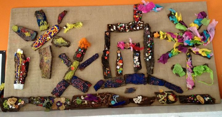 "Decorated bark has been used to create this composition - at The Nest Nursery School ("",)"
