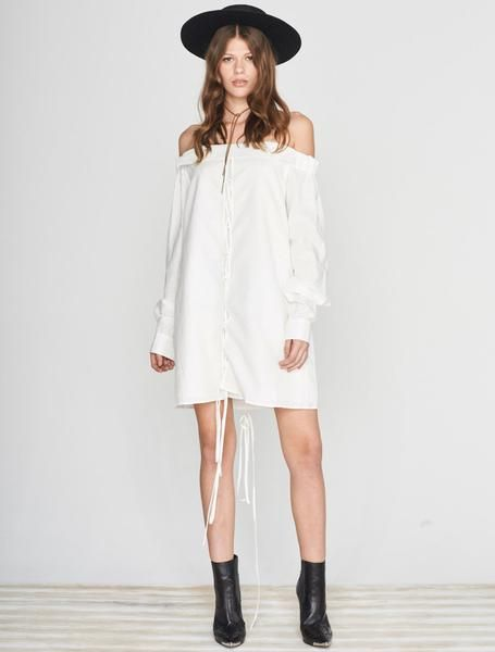 ISLA OLIVIA OFF THE SHOULDER DRESS The hottest runway trend taken straight outta the office. Olivia's a white linen shirt dress that your tan needs for summer. It has an off the shoulder shape, with long button cuff sleeves, and tie-me-up detailing full length front and back. Olivia loves the heat so she's made to be worn loose, if you prefer a slimmer look try the next size down. Available www.islalabel.com
