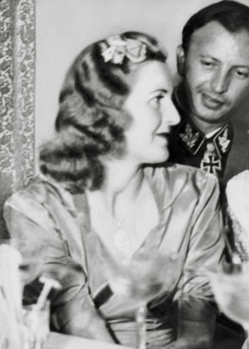Eva Braun next to her sister Gretl (just out of shot) and Hermann Fegelein at the Fegeleins' wedding reception in 1944. (via gentleman-blackbird)