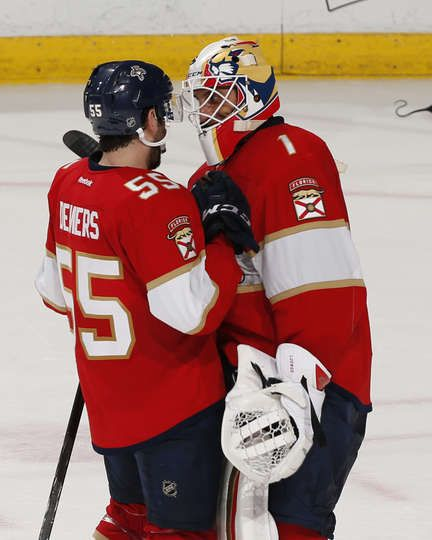 SUNRISE, FL - NOVEMBER 26: Goaltender Roberto Luongo #1 is congratulated by Jason Demers #55 of the Florida Panthers after the game against the Columbus Blue Jackets at the BB&T Center on November 26, 2016 in Sunrise, Florida. The Panthers defeated the Blue Jackets 2-1 in a shoot out. (Photo by Joel Auerbach/Getty Images)