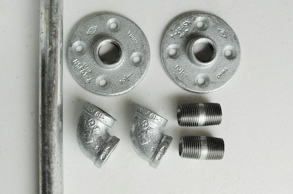 Pipe Parts for DIY Curtain Rods Project.  This would be great for the room.