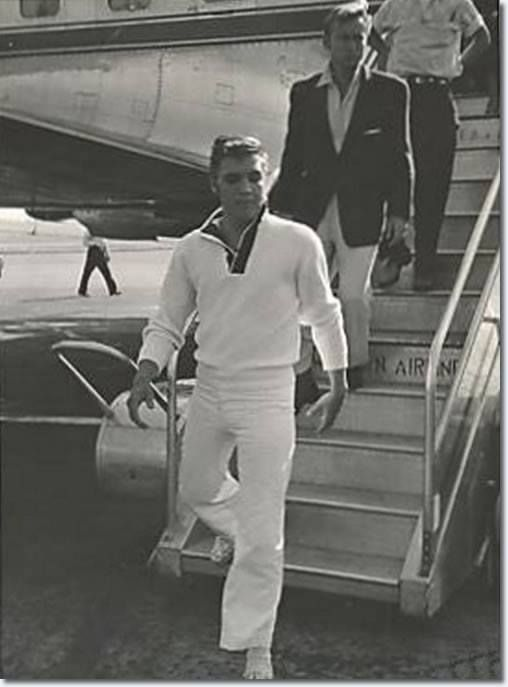 ...... at Memphis Airport. - - - - nobody steps off a plane like ELVIS! Notice actor, Nick Adams, just behind the king.