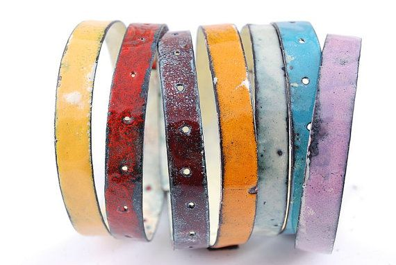 This set of handmade enameled bangles was made of brass (rivet) and copper, carefully enameled in different shades of rich colors, using vitreous lead free enamels of best quality. All bangles and most of its parts were handcrafted in my studio in Warsaw. Bracelets are covered with vitreous glassy enamel also inside, for more smoothness and better comfort of wearing. All edges are smoothly finished and bright. I make custom orders for your ideas and color combinations as well as for already…
