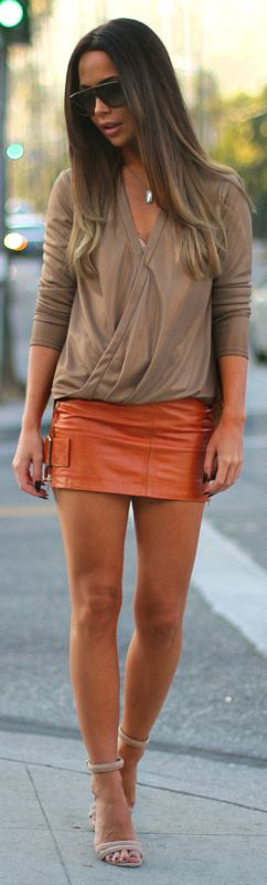 Johanna Olsson + ultra cute + orange leather mini skirt + simple beige V neck top + heeled sandals + hitting the town day or night  Brands Not Specified.