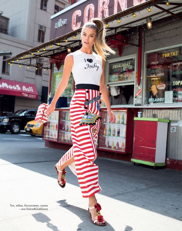 Danish model Nina Agdal wears Dolce & Gabbana shirt, striped skirt and embellished sandals