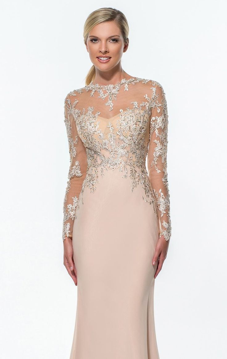 Make heads turn in Terani Couture Evening 151E0296. This alluring evening gown features a high neckline with full sleeves. The beaded sheer fabric wraps over sweetheart bodice. A fitted waistline unfolds to a floor length, fit and flare skirt that gives a sensational look.