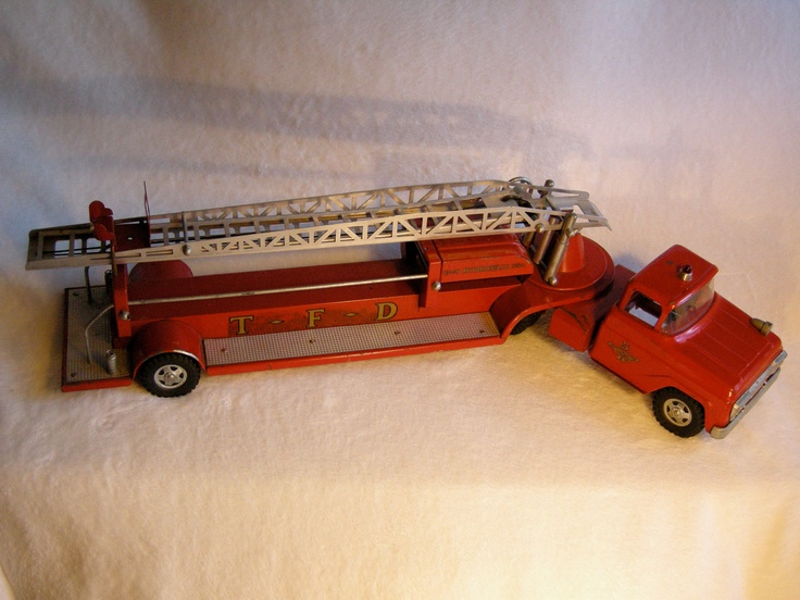 Vintage TONKA FIRE TRUCK No. 48 Hydraulic Aerial Ladder Red Fire Truck. 550.00, via Etsy.