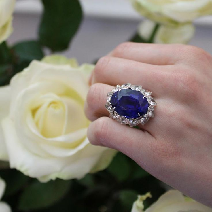 This midnight-blue sapphire ring by David Morris is reminiscent of Princess Diana's iconic engagement ring. Discover the best gemstone for a coloured engagement ring, whether it is traditional or not traditional in design for wedding and bridal season: http://www.thejewelleryeditor.com/bridal/article/sapphire-engagement-rings-number-one-coloured-gem/ #jewelry #rose