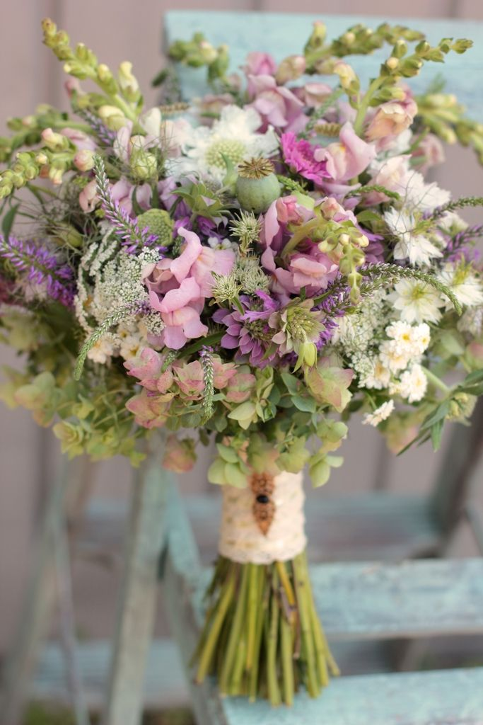 Another late June bridal bouquet with snapdragons, queen anne's lace, bee balm, feverfew, poppy pods, veronica, cosmos, scabiosa, and herbs.  Colors would be different for you but this gives you an idea of what these flowers look like together.