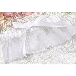 White Bridal Garter . $5.99. This lovely WHITE bridal garter makes a wonderful addition to your wedding or your prom. This WHITE bridal garter is made of satin on top with sheer fabric on the bottom, and finished with a satin and sheer bow on the front of the garter, for a simply classic look.  This WHITE bridal garter is available in 1 standard size, and is is packaged in a white box with a clear, see-through lid.