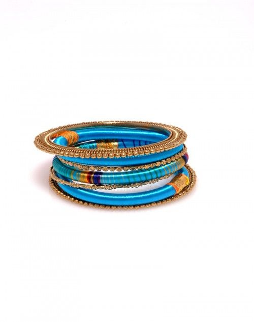 With three skinny silk bangles, two solid and one multi stripe, this theme is driven home by the addition of four golden metal bangles, two of which are powerfully wide and make for beautiful end caps! Each of Laguna's three different color schemes convey a uniquely relaxed, but powerful feeling. www.hamptonbanglecompany.com #bracelets #fashion #jewelry #trend #style #accessory #sexy #bangles  #imaginehappy