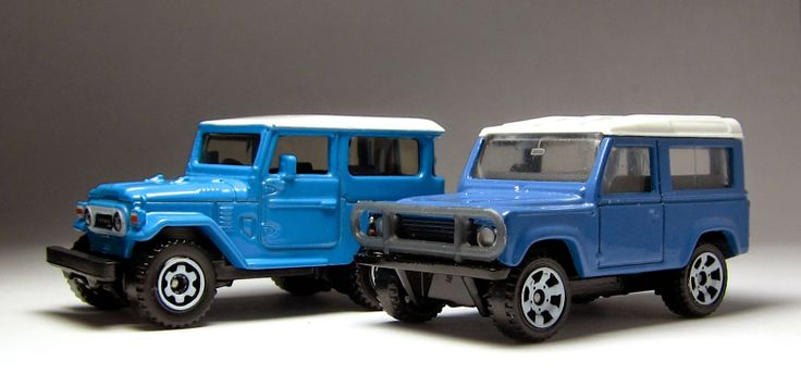the Lamley Group: Cool is Cool is Cool: Matchbox Land Rover Ninety & Toyota Land Cruiser in light blue...