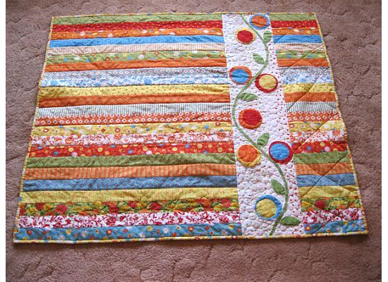 a jelly roll quilt from Piece N Quilt