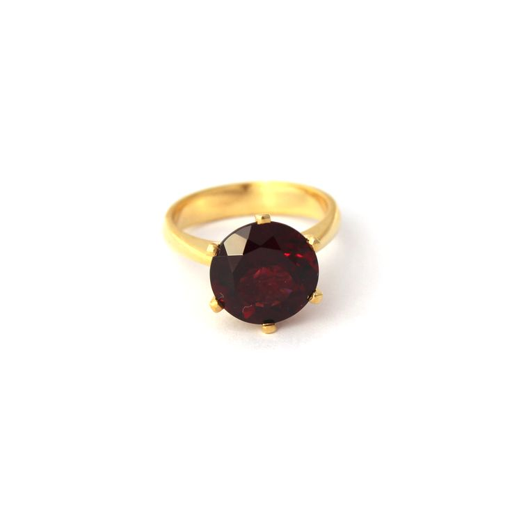 Enchanted Crown Ring Yellow Gold and Rhodolite Garnet | Handmade from 9kt Yellow Gold this stunning cocktail ring is set a 10mm Rhodolite garnet.