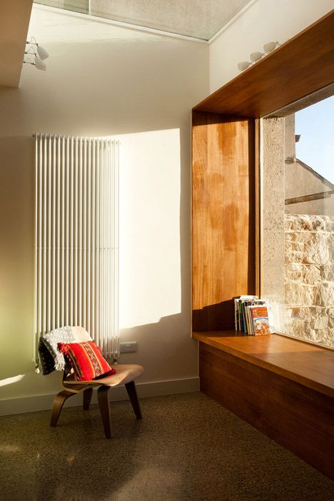 Iroko wood seat/window framing. House extension by GKMP Architects  includes a wooden window seat
