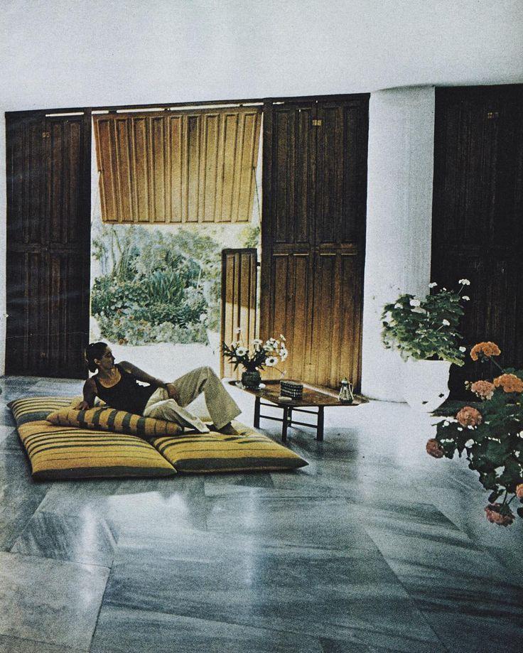 Mica Ertegun, relaxes in front of the garden at her seaside villa in Bodrum, Turkey. Vogue, December 1977.