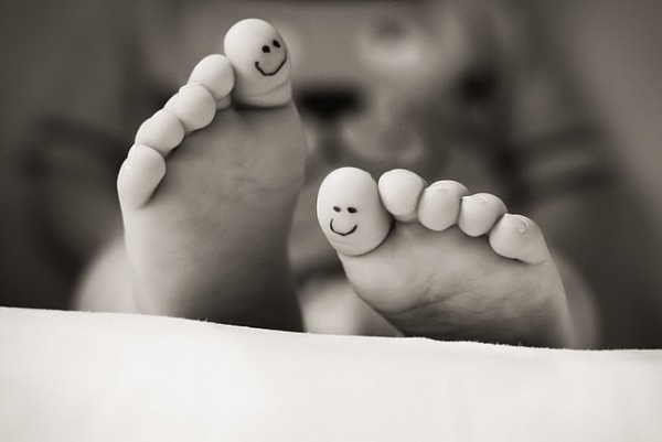 smiley toes - This is pen ink on childrens' feet, but it's a cute idea for a tat.