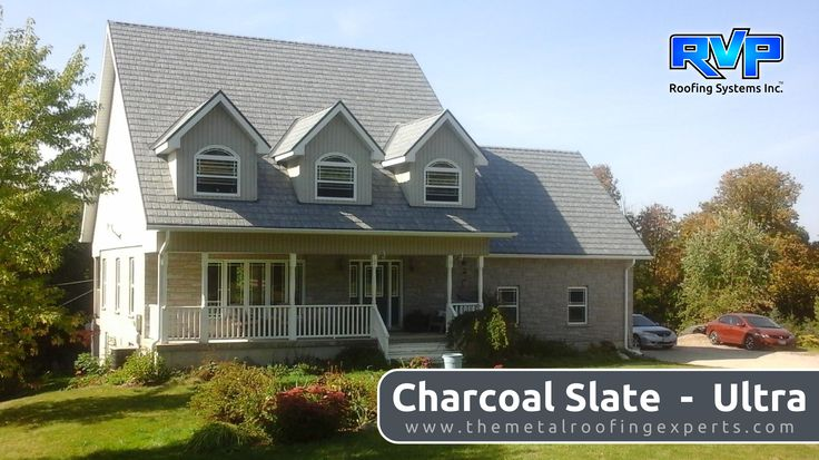 This Charcoal Slate roof will protect this country home for a lifetime.  It looks stunning, set into the surrounding landscape. Visit www.rvp-roofing.com to see more. Don't forget to like and pin! #RVP #highstrengthsteel #permanentroof #armadura #charcoalslate