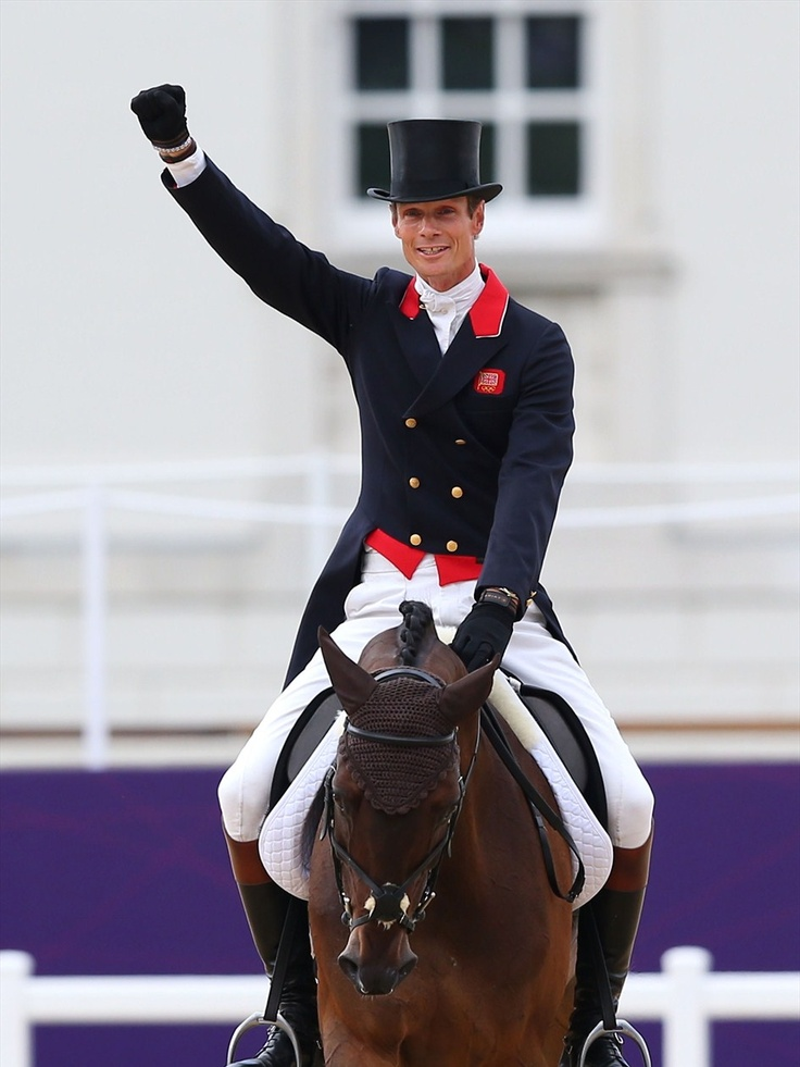 William Fox-Pitt of Great Britain acknowledges the crowed following his Dressage test aboard Lionheart during the Eventing competition at Greenwich Park.