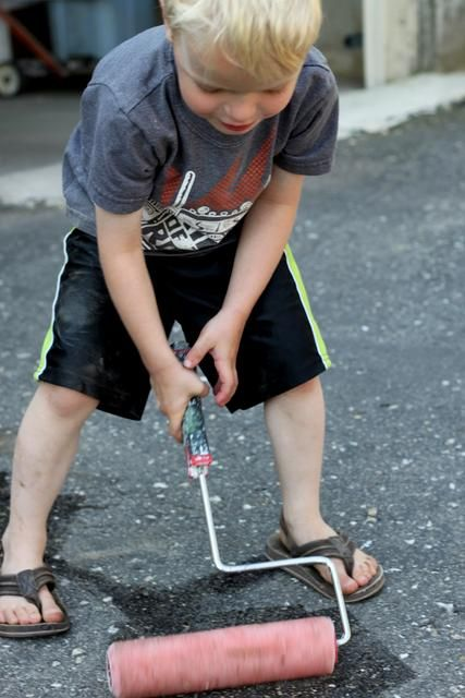 Painting with real tools. Paint rollers, paint brushes and even a paint pan. But with water! Take it outside on the driveway and paint it!