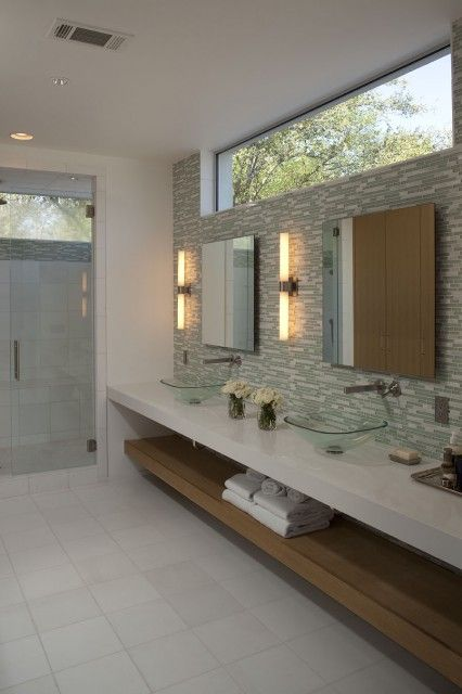 If there is one thing I appreciate, it's a clean bathroom. Like the open shelving...LOVE the tiled wall and walk in shower. Refreshing, clean, and simple.  #SpaBathroom #Tile