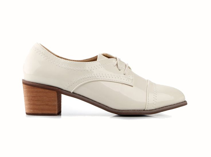 Adara Oxford Heels by Emiwest. Oxford heels with beige color and almond toe accent, stitching details, laces with same color, made from synthetic patent leather, brown heels. Oxford heels provide a sexy or preppy look. http://www.zocko.com/z/JFbcC