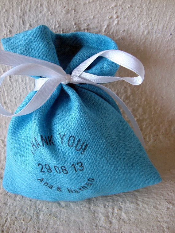 Gorgeous turquoise blue linen favor bags for your big day. Personalised hand stamped text!    This listing is for 50 PIECES. These linen+viscose favor bags will add the perfect rustic touch to your wedding decor.  These have a jute twine as closure. For a more elegant look, the twine can be replaced with satin ribbon. If you choose the satin ribbon, let me know what color youd like.      Please place your order in advance as I am making these bags from scratch and need a few days for…