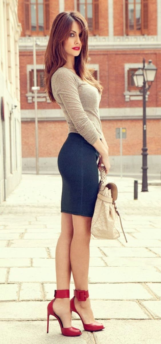 Stylish mini skirt with blouse,handbag and high heels