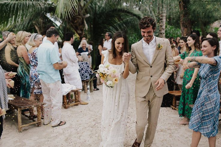 Walking up the aisle as our friends and family showered us with love, cheers, and dried flowers.