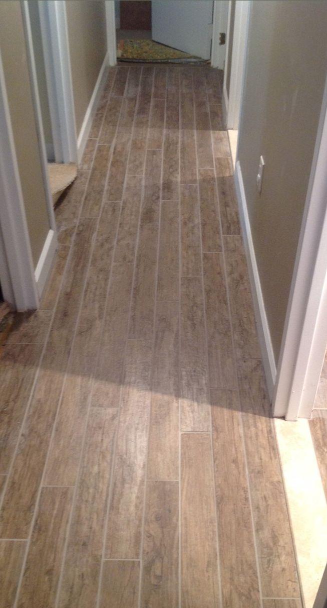 Briarwood mocha fauxwood woodtile thetileshop your for Rugs for basement floors