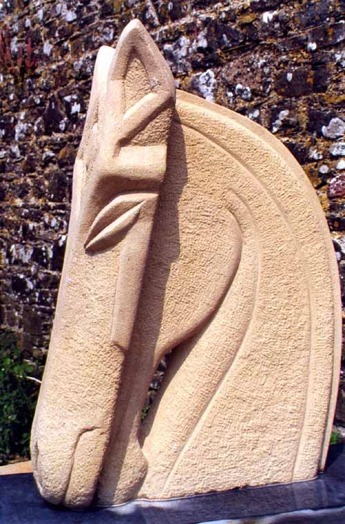 #Limestone #sculpture by #sculptor Perryn Butler titled: 'Horse Mask (Primitive Carved stone Stylised statue)'. #PerrynButler