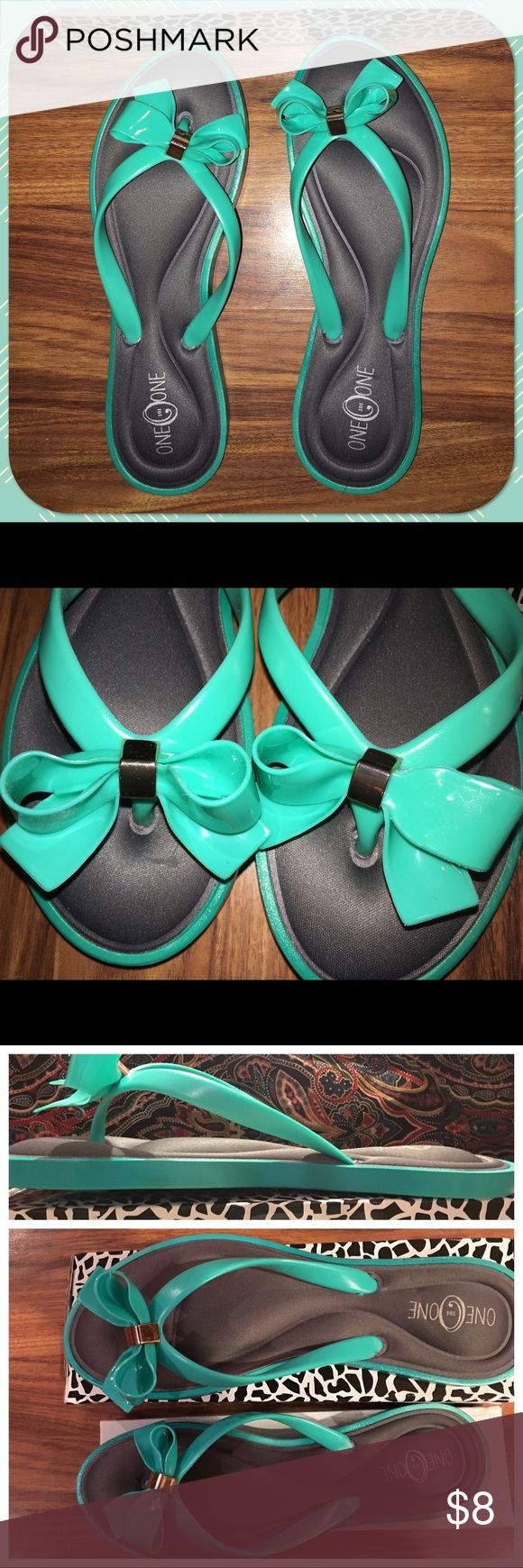 🐠Gel Sole Sandals NIB🐠 Gel sole teal sandals brand new in the box size 10. Hard plastic trim and soft gel inside. Very comfortable with cute bow detail on the top. Fit true to size. They are a true size 10. OneohOne Shoes Sandals